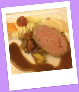 Saddle of veal filled with bacon,marinated with thyme & rosemary oil on fresh vegetables & truffled mashed potatoes