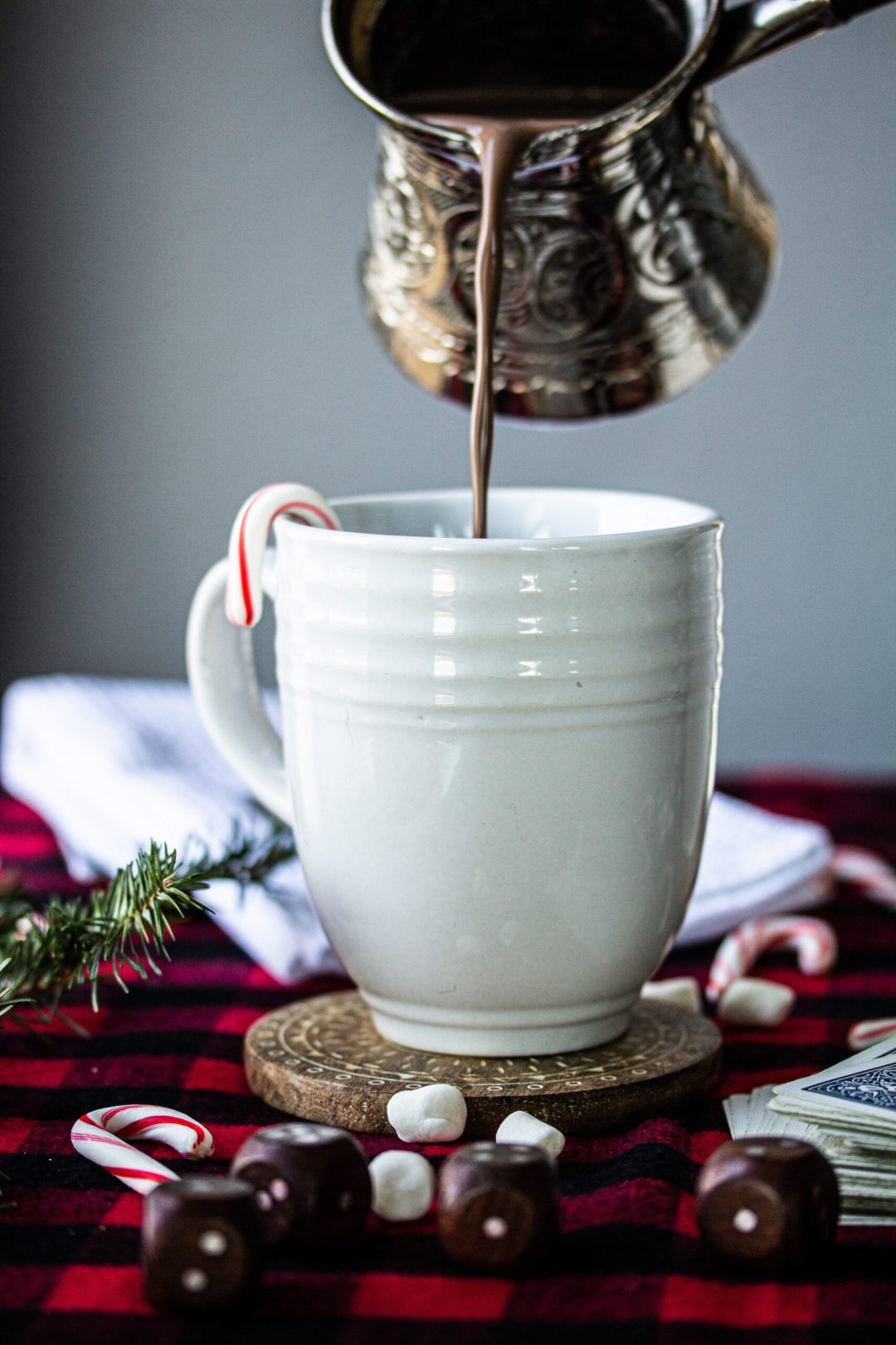 Pouring hot chocolate in mug