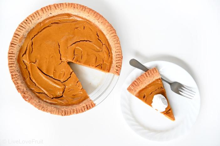 birds-eye view of pumpkin pie with slice taken out