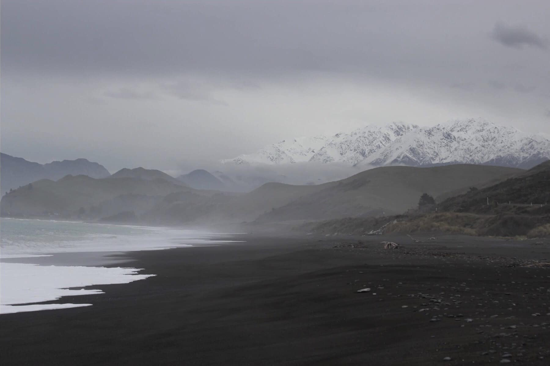 Black sand beach near Kaikoura in New Zealand. Find out if LivingSocial Escapes and Groupon Getaways are good deals or a scam in our Living Social & Groupon travel reviews.