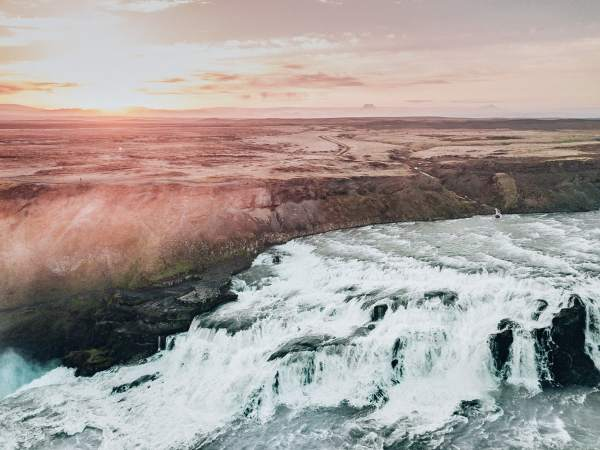 Summer sunset drone shot at Gullfoss on Iceland's Golden Circle. Click for a perfect 6 day Iceland itinerary around Ring Road