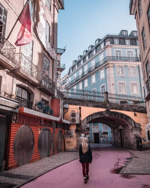 The Instafamous Pink Street in Lisbon. Click here for Lisbon's most Instagrammable places with a free map to plan your trip to Lisbon!