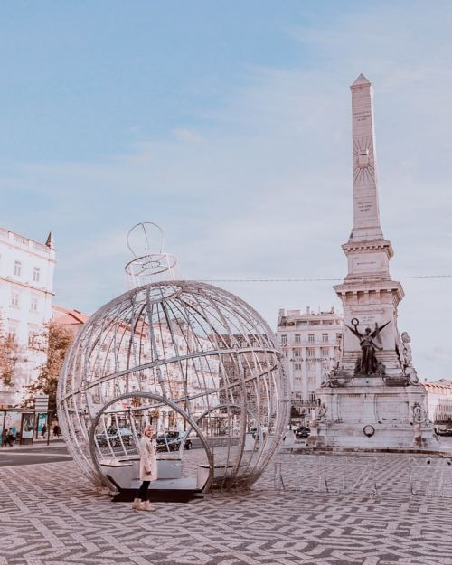 Praca dos Restauradores at Christmas in Lisbon, Portugal. Click here for a list of the best photo locations in Lisbon plus a free map!