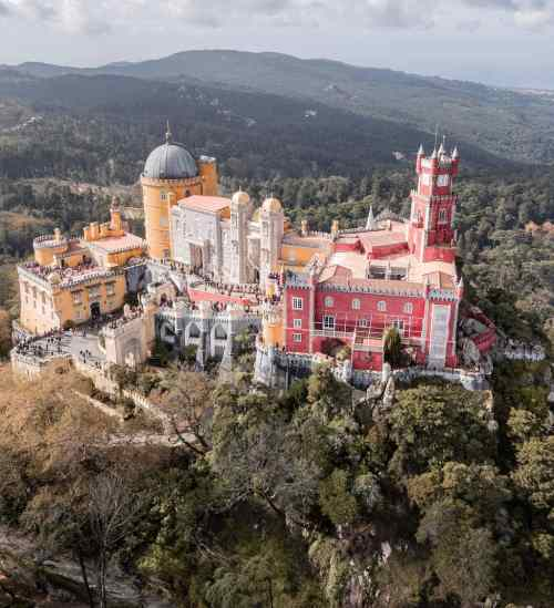 Drone shot from Pena Palace from above in Sintra, Portugal