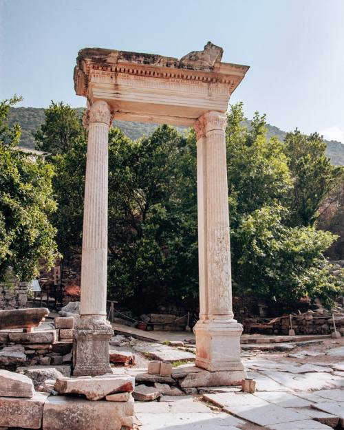 Two columns still standing in ancient Ephesus. Find a full one day itinerary with everything you need to know about visiting the ancient ruins of Ephesus in Turkey here.