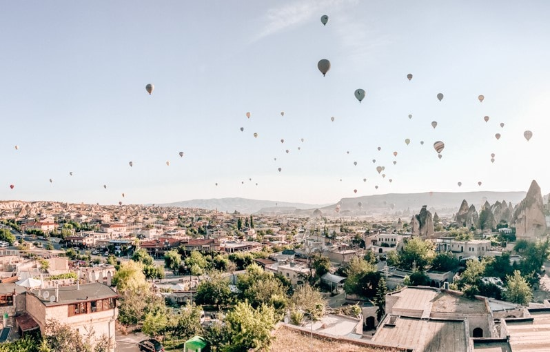 Most mornings in Cappadocia start with a hot air balloon sunrise. Check out the ultimate guide to exploring the best Turkey travel destinations on an epic road trip adventure! #turkeytravel #cappadocia #cappadociaturkey #cappadociaphotography