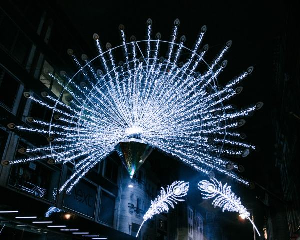 The lights on Bond Street are peacock themed at Christmas. Check out this full list of the best Christmas lights in London with a free map!