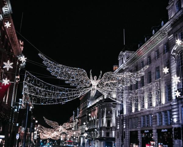 Angels made of Christmas lights near Piccadilly Circus at Christmas. Find all the best London photo spots at Christmas here plus a free map!