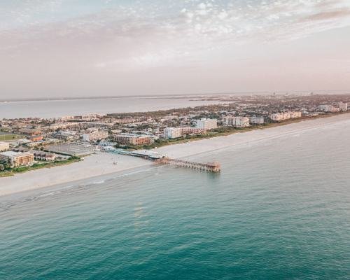 A drone shot of the Westgate Cocoa Beach Pier which extends 800 feet. Find out why Cocoa Beach is perfect for your next Florida beach vacation.