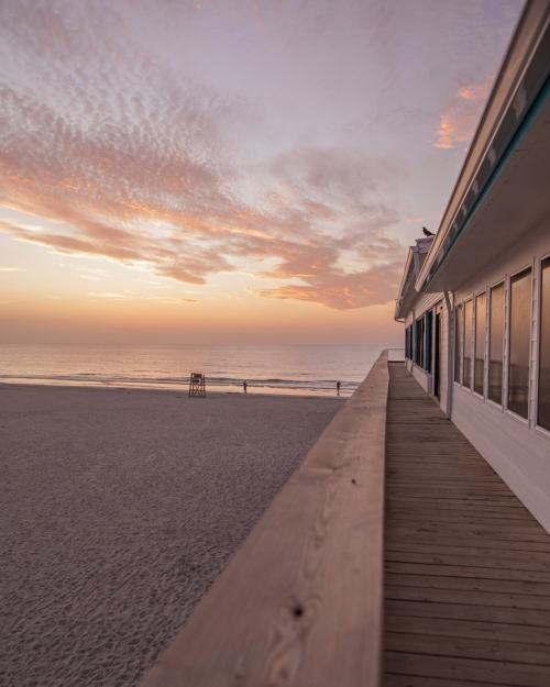 The Westgate Cocoa Beach Pier at sunrise - find the best place for a Florida beach vacation here!