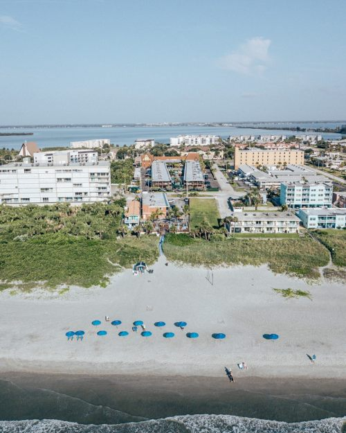 Drone shot of Westgate Cocoa Beach Resort including the beach concierge area. Find a full review of everything this Cocoa Beach hotel has to offer for a perfect Florida beach vacation.