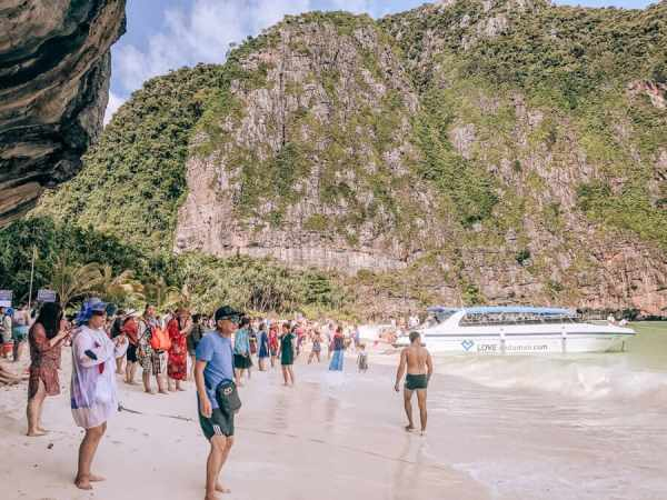 The crowds on the beach at Maya Bay in Thailand