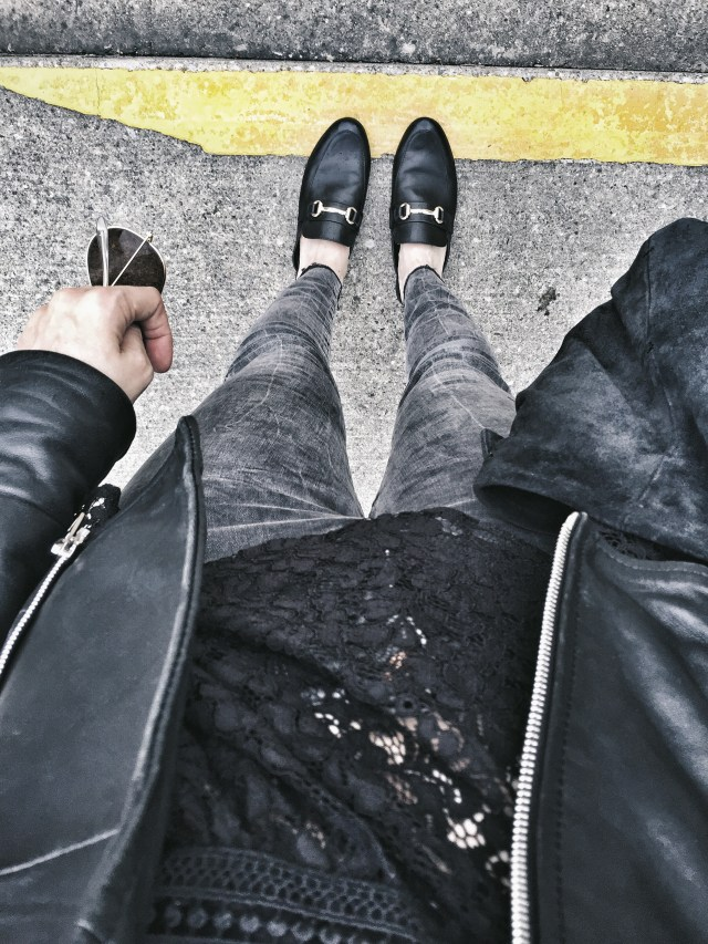 slides. lace top, grey jeans, and leather jacket