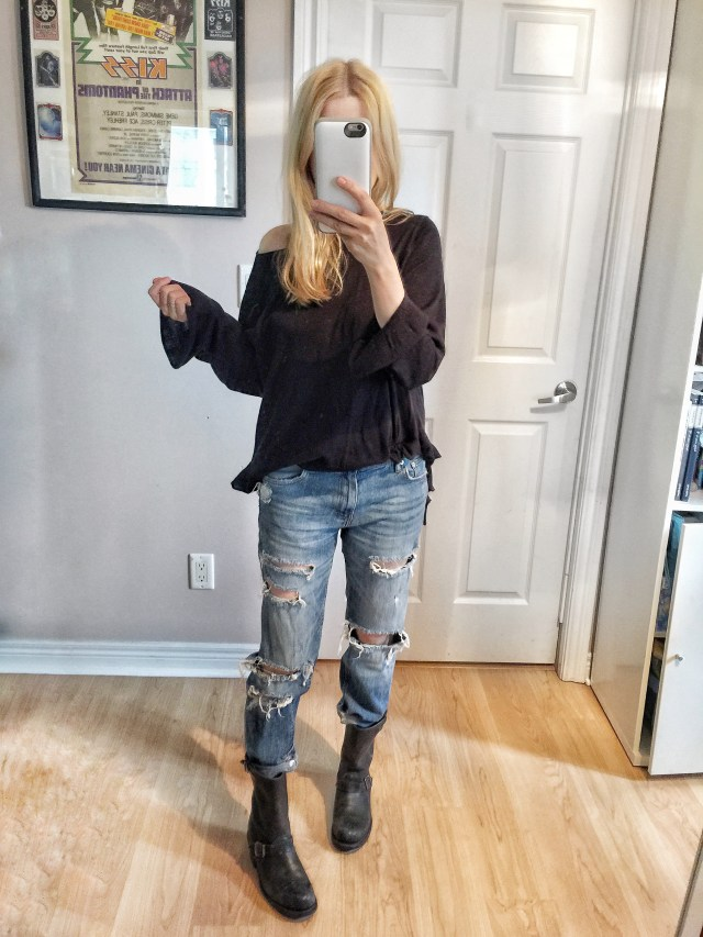 Black sweater, distressed boyfriend jeans, and Frye Engineer boots