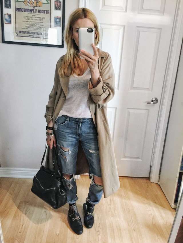 Trench, knotted tee, distressed jeans, fishnets, and slides