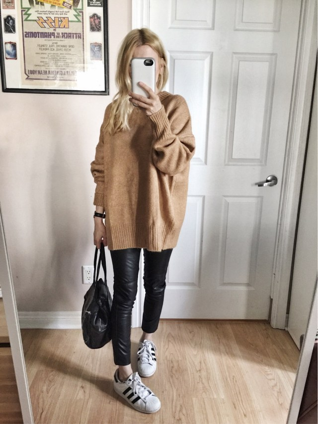oversized camel sweater, faux leather pants, and Adidas
