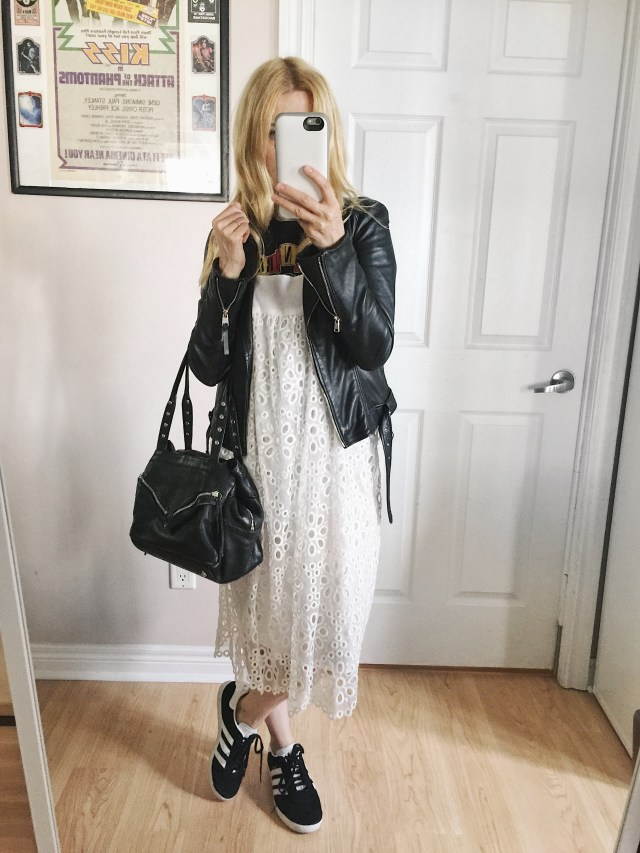 White border anglaise sundress, band tee, leather jacket, and Adidas