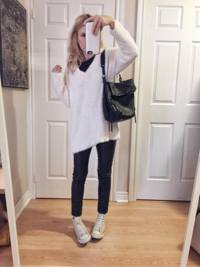 White sweater, black tee, faux leather pants, and converse