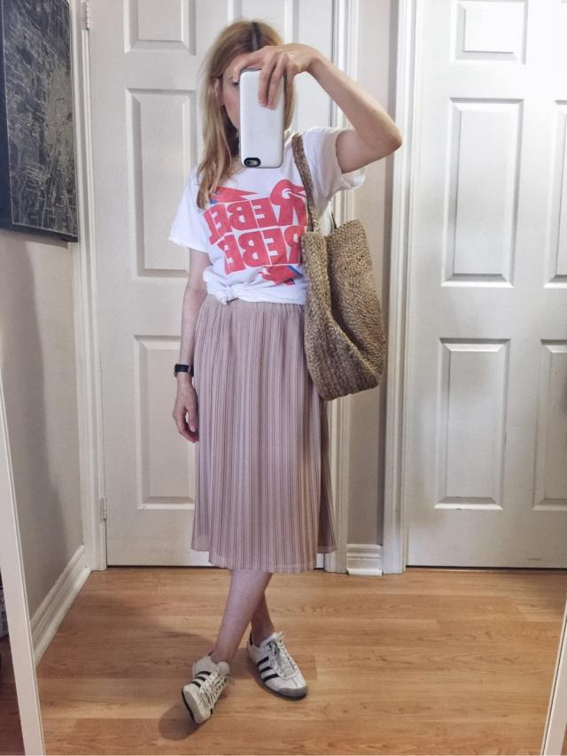 I am wearing a Rebel Rebel Bowie T-shirt | A pink pleated skirt | vintage Adidas | and a woven circle purse