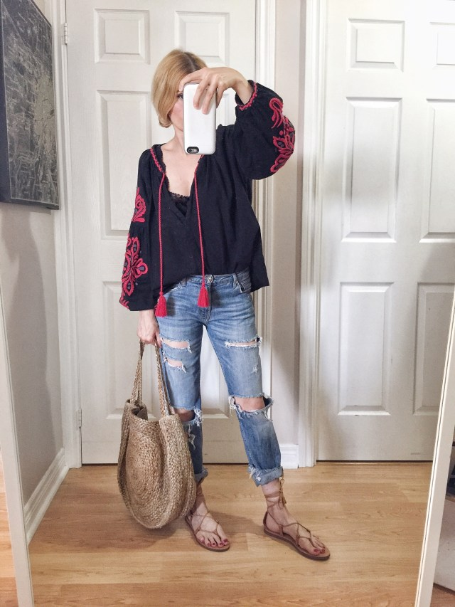I am wearing an embroidered peasant, boyfriend jeans, Madewell Boardwalk sandals, and a large woven circle bag.