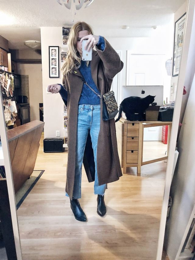 What I Wore. I am wearing a blue fuzzy sweater, cropped jeans, black booties, and a long wool coat.