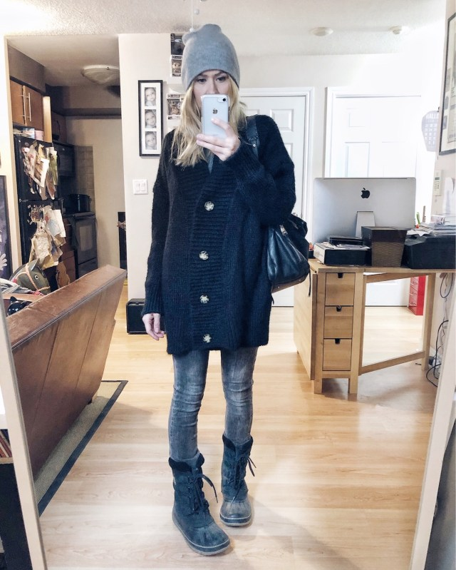 What I Wore. I am wearing grey skinny jeans, an oversized black cardigan, a beanie, and my Sorel boots.
