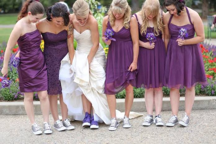 The New Trend Of Bridesmaids Rocking Sneakers On A Wedding Train