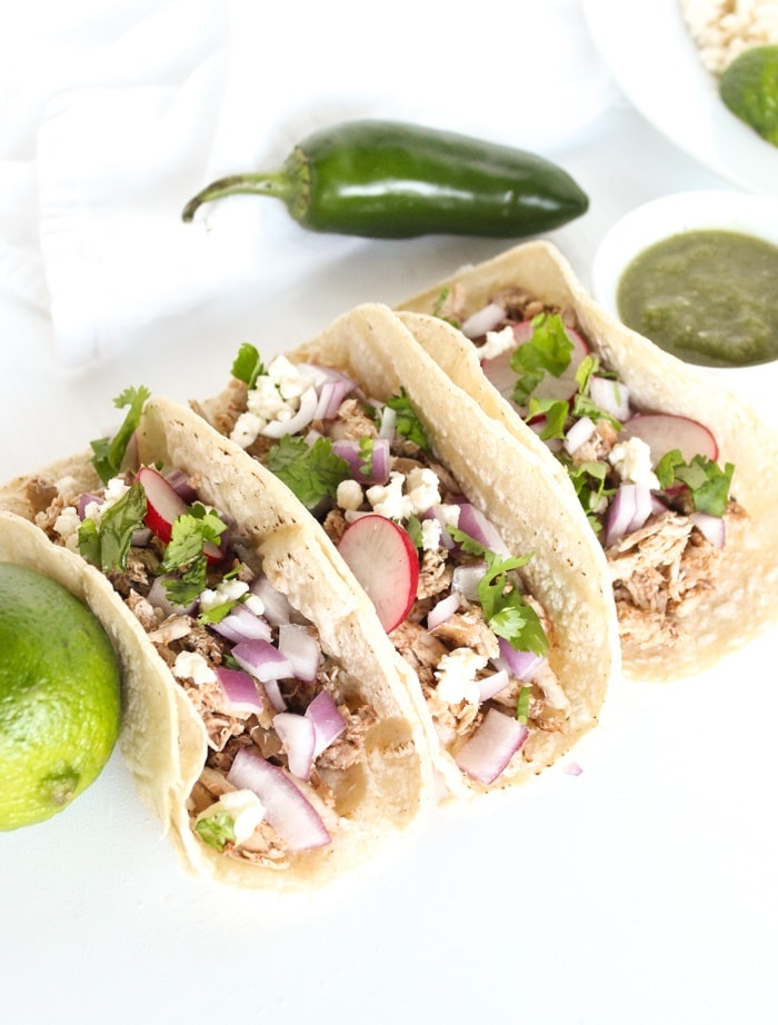 Pulled Quail Tacos are filled with deliciously tender, slow cooked quail for a flavorful Taco Tuesday meal! (gluten-free) via livelytable.com