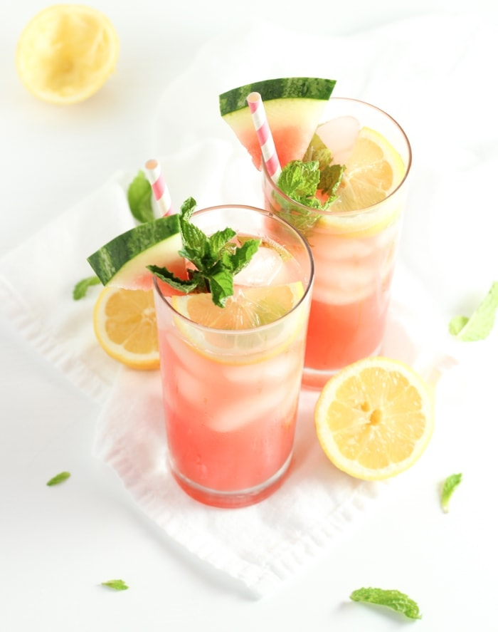 This all natural sparkling watermelon mint lemonade has no added sugar for a healthy and refreshing summer drink that is perfect for backyard BBQs and summer parties! Make it adult with a splash of vodka or serve it as-is for kids. (vegan, gluten-free, sugar-free) | via livelytable.com