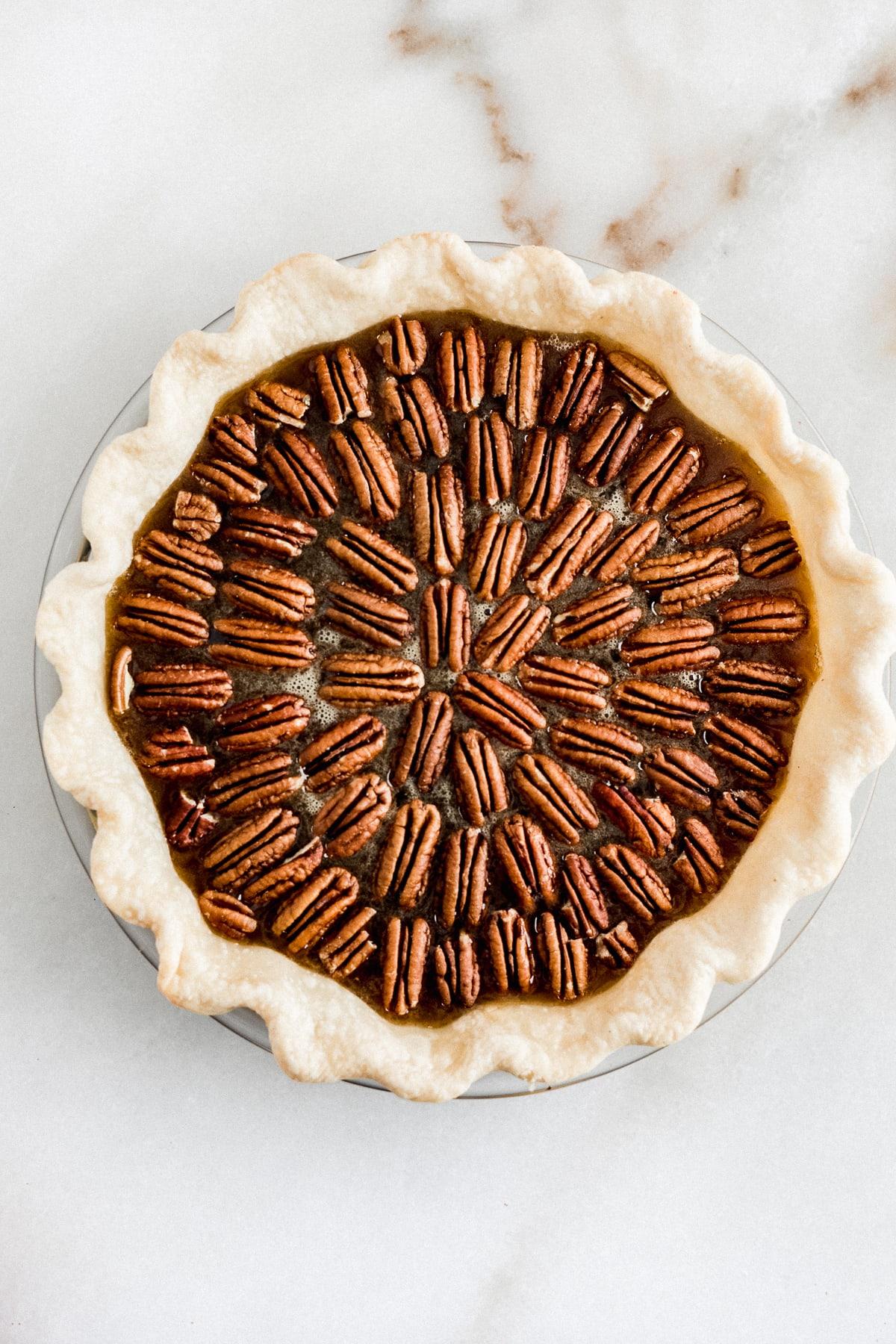 overhead view of pecan pie before baking.