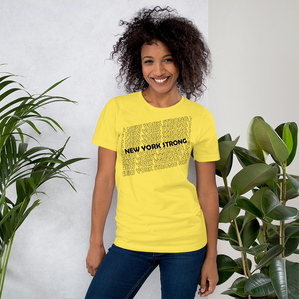 Woman wearing Yellow New York Strong t-shirts