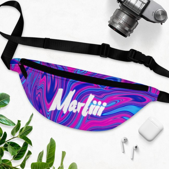 Marliii Bum Bag, Fanny Pack with white background, near a camera and leaves. Multiple colours, Pink Purple and Blue from Live Mic Independent Record Label Services
