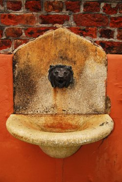 George Melly drinking fountain