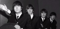 Black and white image of the Beatles