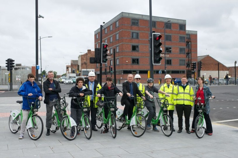 Cllr-Malcolm-Kennedy-with-the-team-involved-in-the-Leeds-Street-project-and-cyclists-from-St-Francis-of-Assisi-Academy