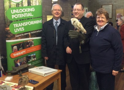 Cllrs Frank Hont, Jeremy Wolfson and Ruth Hirschfield with Mango the owl.