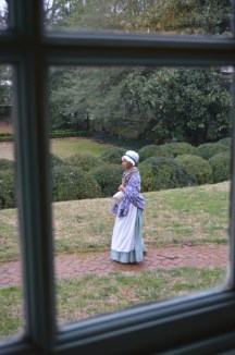 Hetty (Ashlee' James), an enslaved washerwoman and house servant for the Lewises, overheard party guests talking about Lord Dunmore's offer of freedom to slaves and wonders if she ought to run away to the British side.