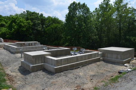 The completed concrete cradle that the interpretive replica will rest on. The cradle protects the Washington house's original archaeological remains underground.