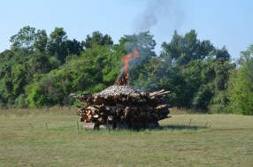 10:05 a.m. - The wick is lit and slowly burns down lighting the ends of the logs on fire.