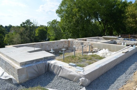 The concrete cradle and stone foundation...
