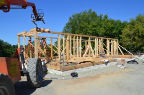 Wall framing for the front portion of the house is nearly complete.
