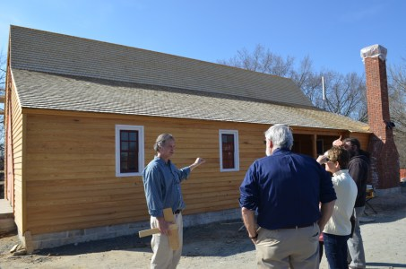 John Jeanes, project manager for the Washington house construction, discusses the project with visitors.
