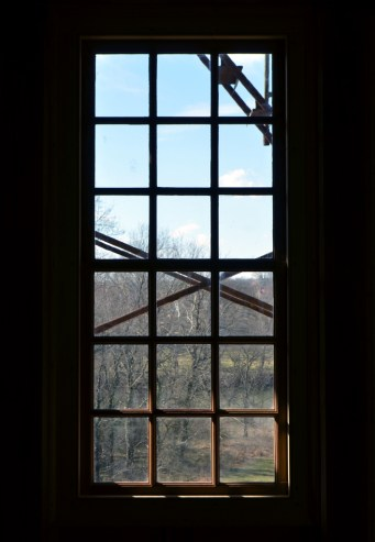 View from inside the house through one of the windows down to the river.