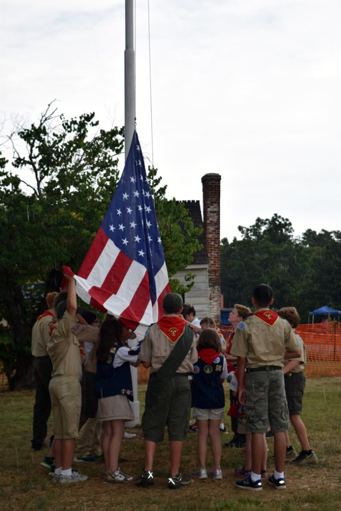 The new flag is raised as rain begins to fall.