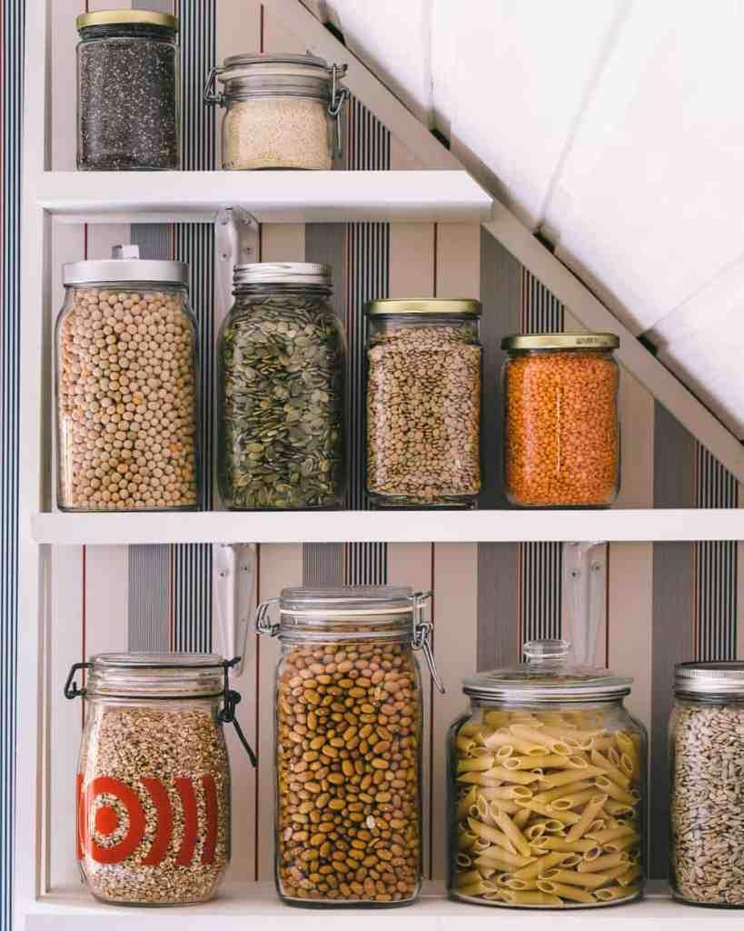 Jars of pantry items on a shelf.