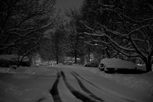 Black and white picture of a snowy night time scene