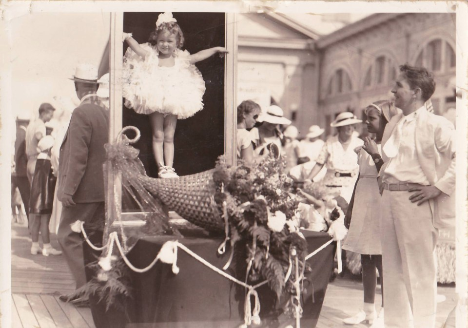 My grandmother in a baby parade at the New Jersey Boardwalk standing on a flower-covered float inside a picture frame