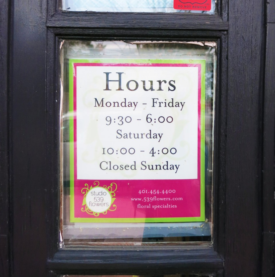 Hours sign for Studio 539 Flowers located on Wickenden Street in Providence, RI