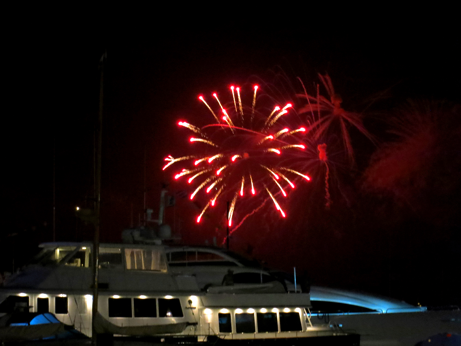 ROCKET'S RED GLARE OVER NEWPORT HARBOR - live. travel. adventure. bless. | Red and gold firework bursting over the yachts in Newport Harbor during the Independence Day fireworks display. Happy 4th of July!