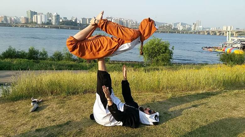 We just couldn't resist doing some acro yoga in onesies!